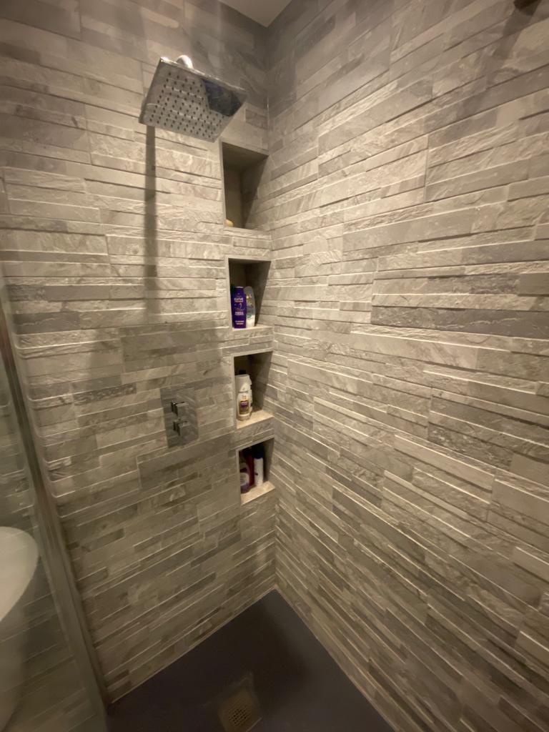 Modern bathroom with square fixed rain head