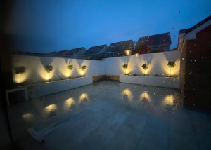 Renovated outdoor patio area with aesthetic lights installed, Image 8